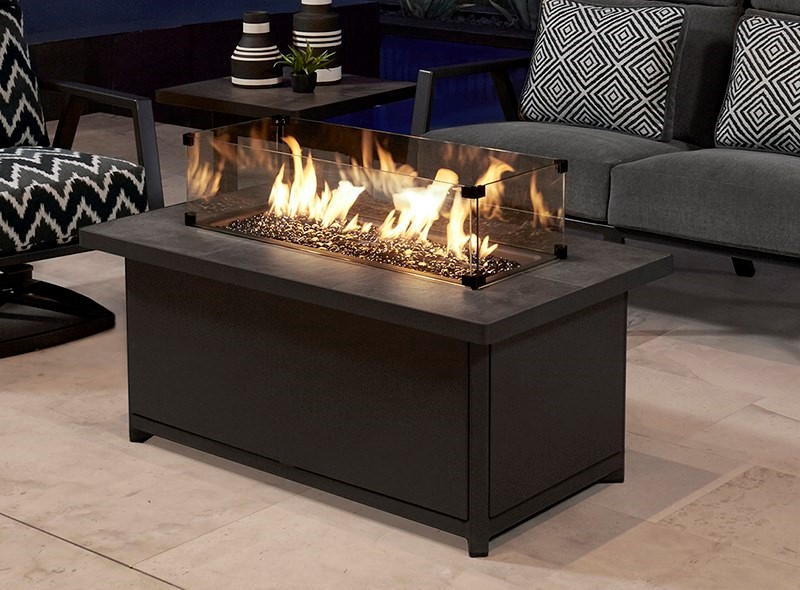 Firepit - Dark wood firepit in the middle of a deck or patio