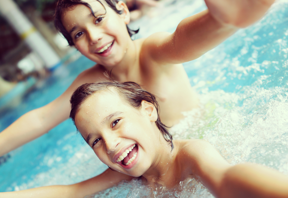 pool chemicals, chlorine - Kids in pool having fun